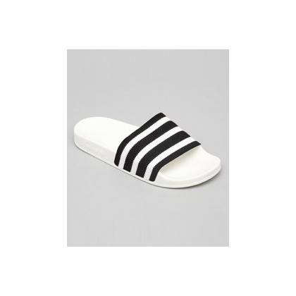 Adilette Slides in Core Black/Ftwr White/Off by Adidas