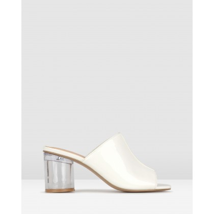 Icy Cylinder Heel Mules White Patent by Zu